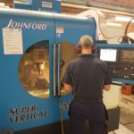 Toggle latch CNC machine operated by Ojop Sweden AB employee