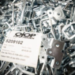 Box full of Ojop latch components with products label on top